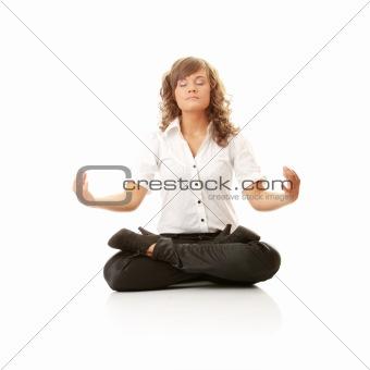 Businesswomen meditating in lotus position