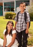 Cute Hispanic Brother and Sister Wearing Backpacks Ready for School.