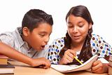 Hispanic Brother and Sister Having Fun Studying Together Isolated on a White Background.