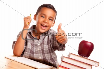 Adorable Hispanic Boy with Books, Apple, Pencil and Paper Isolated on a White Background.