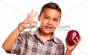 Adorable Hispanic Boy with Apple and Okay Hand Sign Isolated on a White Background.