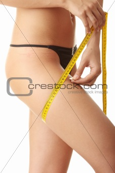 Slim woman measuring her leg