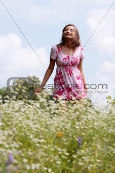 Smile teen open hands standing on field
