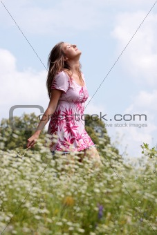Smile teen open hands standing on field