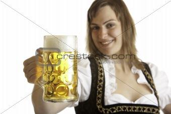 Bavarian woman holds Otoberfest beer stein