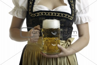 Bavarian Woman in Dirndl holds Beer stein at Oktoberfest