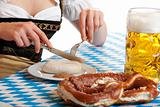 Close-up of Bavarian Girl having typical Oktoberfest meal
