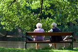 Senior couple on the bench near lake in park