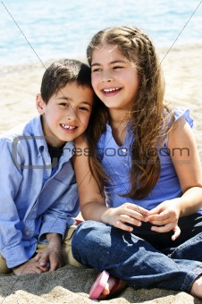 Brother and sister at beach