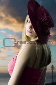 blond girl and red hat