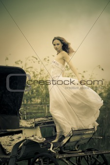 beautiful bride and old  carriage / retro style toned