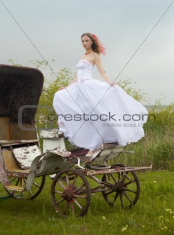 beautiful bride and old  carriage