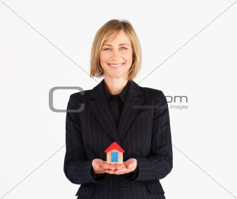 Business woman Holding a House