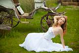 	beautiful bride and an old  carriage