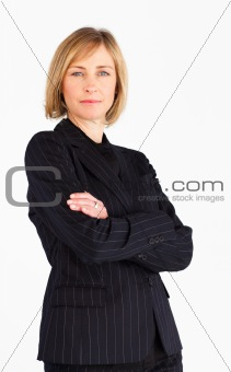 Blonde businesswoman with crossed arms