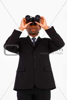Friendly well-dressed businessman with binoculars