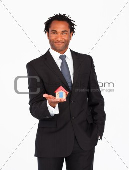Afro-american businessman presenting house