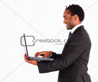 Afro-american businessman working on laptop