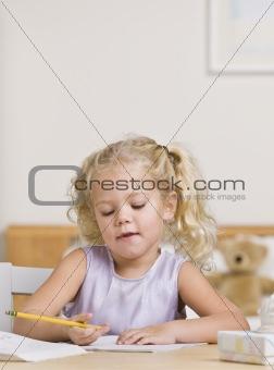 Beautiful Little Girl Writing