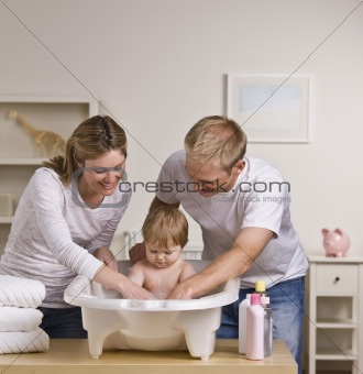Happy Parents Bathing Baby