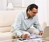Man Paying Bills With Laptop