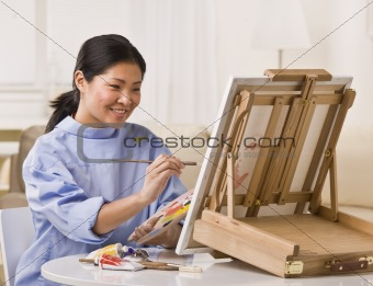 Asian woman painting