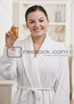 Woman Holding Bottle of Pills