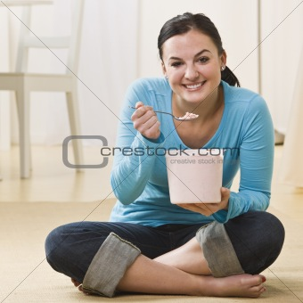 Attractive woman eating ice cream.