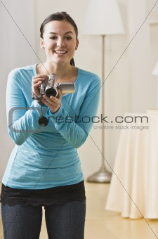 Attractive woman with video camera.