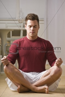 Attractive male in lotus position.