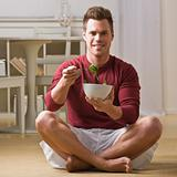 Man with bowl of salad