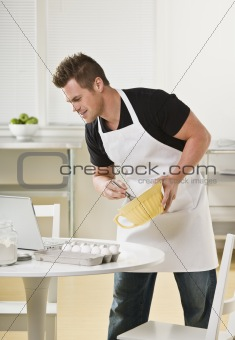 Attractive male with mixing bowl