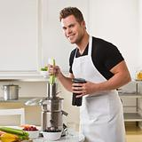 Attractive male with juicer.