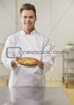 Attractive male with pie.