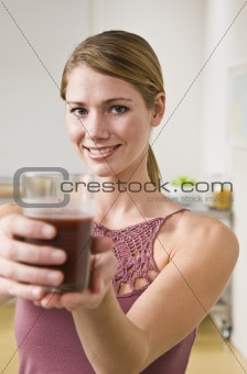 Blonde woman with smoothie.