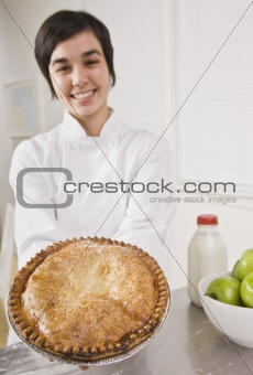 Attractive woman holding pie.