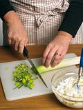 Chef cutting leek