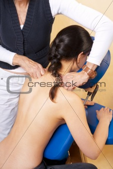 Woman gets massage, acupressure on her shoulder