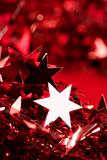 Christmas star decoration still on red background