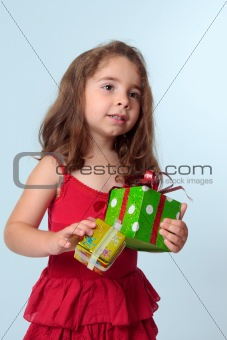 Little girl holding Christmas presents