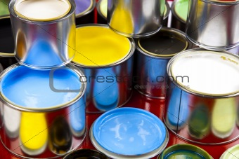 Cans and paint on the colourful