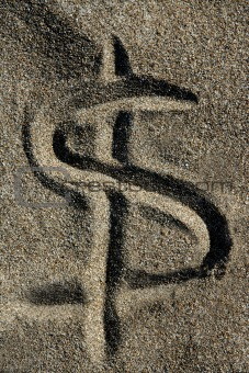American currency  dollar sign on the beach sand