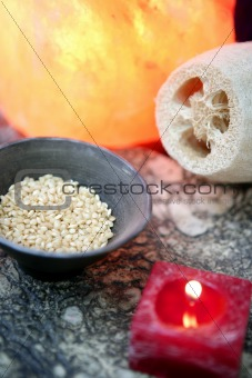 Aromatherapy, red candle, sea marine natural sponge and bowl of rice