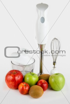 Blender with different ripe fruits