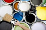 Cans and paint and brushes on the Colorful
