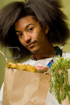 Close Up of Young African American Chef with Groceries