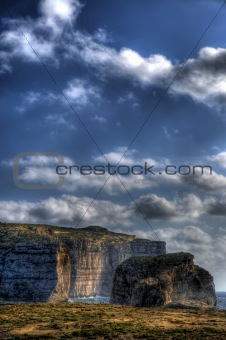 A HDR scenic view of Fungus Rock on the coast of Gozo in the Med