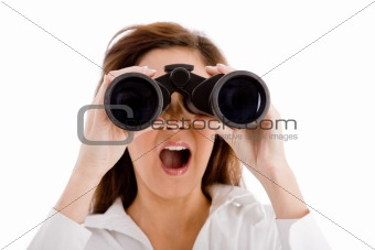 portrait of shocked woman looking through binocular
