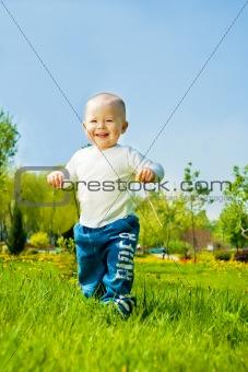 Baby boy running