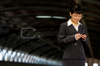 Asian business woman with mobile phone